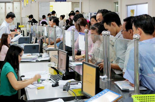 Đông đảo doanh nghiệp đến tìm hiểu và đăng ký kinh doanh theo Luật Doanh nghiệp mới -Ảnh: Quốc Hùng